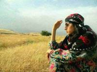 Kurdish Lady waiting for her Hero