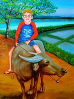 Boy Riding a Carabao