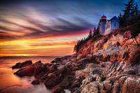 Lighthouse on a Cliff at Sunset