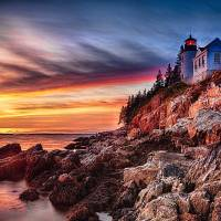 Lighthouse on a Cliff at Sunset Art Prints & Posters by George Oze