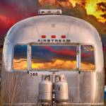 """Airstream Travel Trailer Camping Sunset Window Vie"" by lightningman"