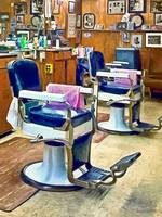 Two Barber Chairs With Pink Striped Barber Capes