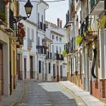 """Sunny street of Spanish city Granada"" by olegmit"