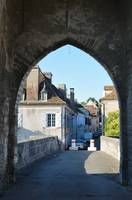 French town through the ancient stone arch
