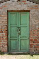 Green Wood Door in Adobe Wall