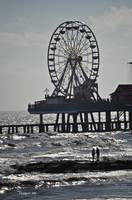Pleasure Pier with Lovers Watching Surfer