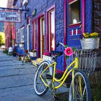 Yellow Bicycle At The Silverton Hostel Art Prints & Posters by George Oze