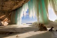 Cavern behind ice curtains on Grand Island on Lake