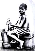 afri-kid-grinding-corn-in-motar.gif