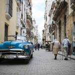 """Old car and people in Havana Vieja"" by jcarillet"