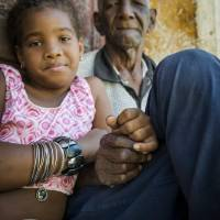 Old man and young girl in Trinidad, Cuba Art Prints & Posters by Joel Carillet