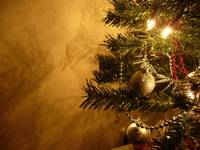 Golden Christmas Ornaments Hanging On The Tree