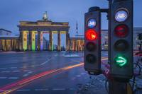 Traffic lights with Brandenburg Gate at dusk