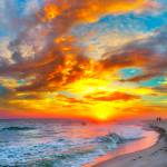 """red ocean sunset orange beach clouds"" by eszra"