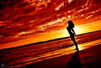 Woman Red Sunset Silhouette w Sun & Clouds