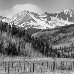 """Valley and Rocky Mountains in Black and White"" by lightningman"