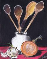 onion, wooden spoons, and a canister w red fabric,