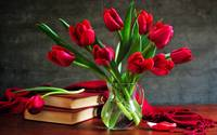 Red Tulips And A Stack Of Books