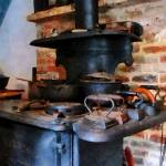 """Irons Heating On Stove"" by susansartgallery"