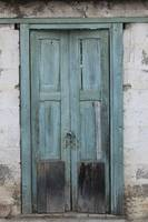 Blue Weathered Door in a Wall