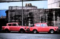 Two Red Ford Anglias