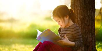 Young Girl Enjoys A Good Book