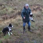 """Irish Farmer carrying Lamb, followed Border Collie"" by FingerLakesPhotos"