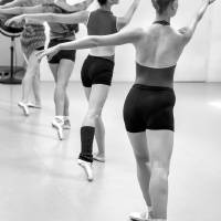 Four female dancers during a ballet rehearsal Art Prints & Posters by Julia Hiebaum