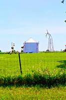 Grain Augers, Silo, And An Old Windmill