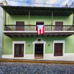"""House with a Balcony and a Flag in Old San Juan"" by George_Oze"