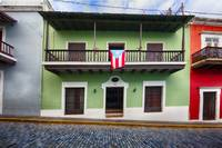 House with a Balcony and a Flag in Old San Juan