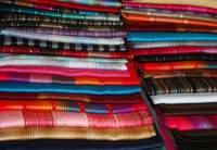 Stacks of Colorful Shawls