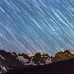 """Stars Raining Down On The Colorado Indian Peaks"" by lightningman"