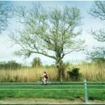 """Girl on Bike"" by micspics444"