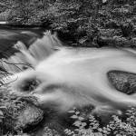 """Mountain Stream Waterfall in Black and White"" by lightningman"