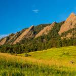 """Boulder Colorado Flatirons Sunrise Golden Light"" by lightningman"