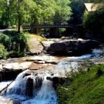 """Waterwheel bridge with waterfall"" by globetrotter1"