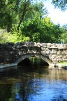 Stone Bridge over a Pond