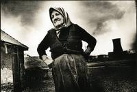 farmer`s wife in front of power plant