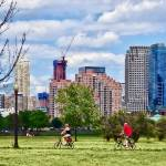 """Couple Cycling in Liberty State Park"" by susansartgallery"