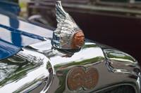 1926 Pontiac Mascot and Badge From Left