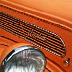 """Orange Ford Anglia Bonnet iwth Badge"" by janesclassiccarphotos"