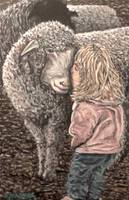 Girl kisses sheep