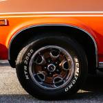 """Orange Chevy Nova coupe side front view"" by felixpadrosa"