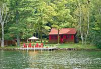 Red Chairs and a Cabin