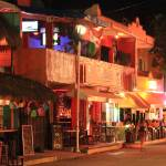 """Street secne at night, Playa del Carmen, Mexico"" by RoupenBaker"