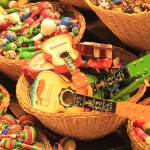 """Colorful Mexican Guitar and Music Toys in Baskets"" by RoupenBaker"