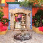 """Courtyard Entrance, Playa Del Carmen Mexico"" by RoupenBaker"