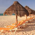 """Waiting beach chairs, Playa del Carmen"" by RoupenBaker"