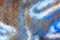 Chain Link Fence and Painted Wall